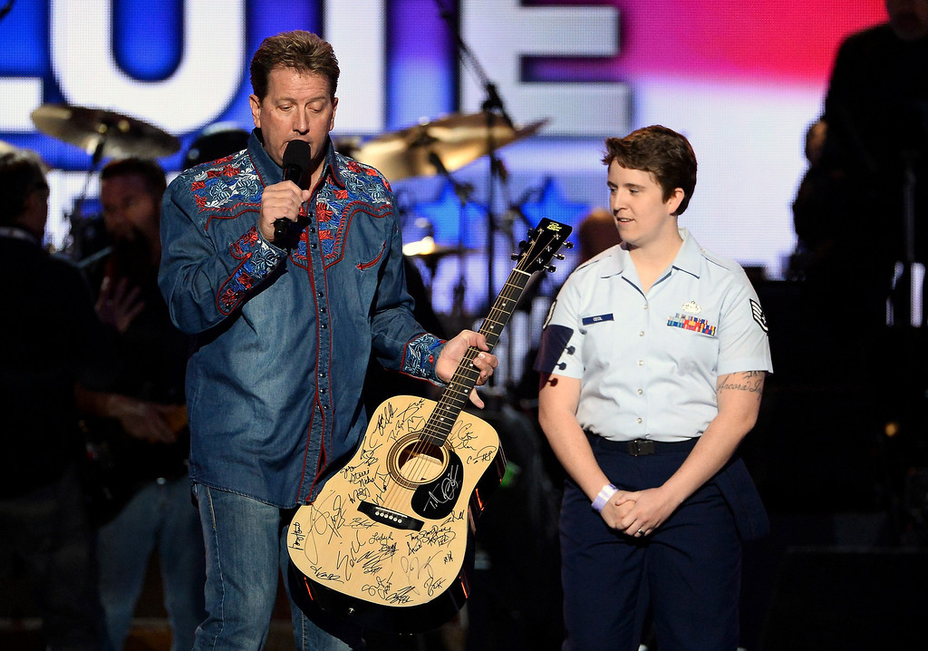 . Entertainer Shawn Parr (L) and ACM Lifting Lives contest winner Navy Sgt. Cecil speak onstage during ACM Presents: An All-Star Salute To The Troops at the MGM Grand Garden Arena on April 7, 2014 in Las Vegas, Nevada.  (Photo by Ethan Miller/Getty Images for ACM)