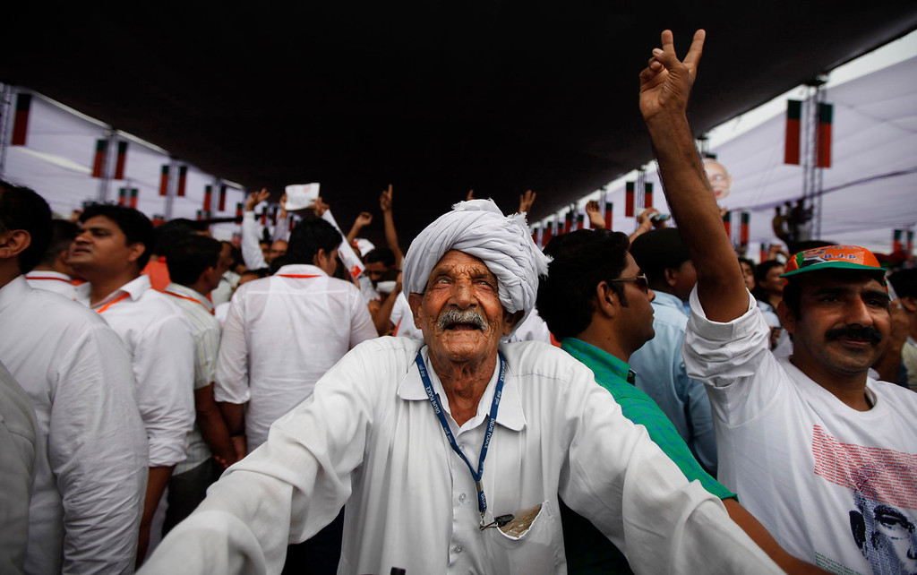 . An elderly man listens to a speaker at a political rally in New Delhi on Sunday, Sept. 29, 2013. Much of the world is not prepared to support the ballooning population of elderly people, including many of the fastest-aging countries, according to a global study scheduled to be released Tuesday, Oct. 1, by the United Nations and an elder rights group. (AP Photo/Altaf Qadri)