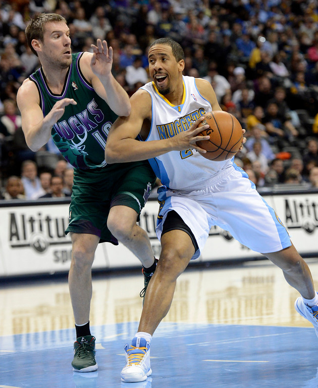 . DENVER, CO. - FEBRUARY 05: Andre Miller (24) of the Denver Nuggets drives on Beno Udrih (19) of the Milwaukee Bucks during the first quarter February 05, 2013 at Pepsi Center. The Denver Nuggets take on the Milwaukee Bucks in NBA action. (Photo By John Leyba/The Denver Post)