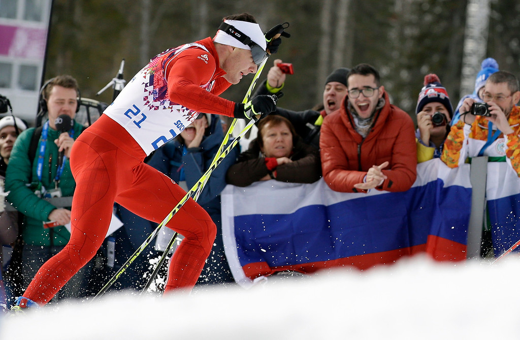 . Switzerland\'s Dario Cologna races to get the gold medal in the men\'s cross-country 30k skiathlon, at the 2014 Winter Olympics, Sunday, Feb. 9, 2014, in Krasnaya Polyana, Russia. (AP Photo/Lee Jin-man)