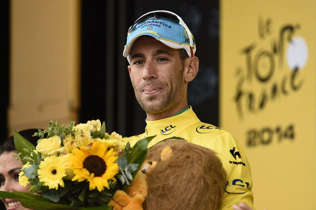 . Italy\'s Vincenzo Nibali celebrates his overall leader yellow jersey on the podium at the end of the 208.5 km nineteenth stage of the 101st edition of the Tour de France cycling race on July 25, 2014 between Maubourguet Pays du Val d\'Adour and Bergerac, southwestern France.  AFP PHOTO / ERIC  FEFERBERG/AFP/Getty Images