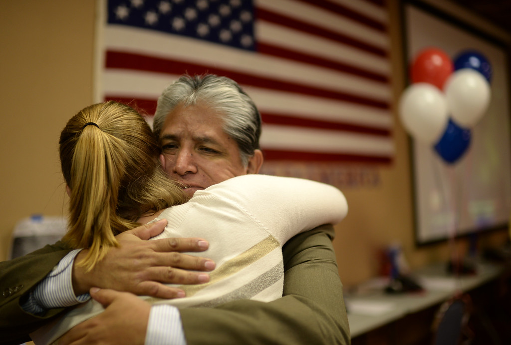 . COLORADO SPRINGS, CO - September 10 : Jayne Oakes, left, and Ron Palacioz celebrate Bernie Herpin\'s win at Colorado El Paso County Republican Party Headquarters. Colorado Springs, Colorado. September 10, 2013. (Photo by Hyoung Chang/The Denver Post)