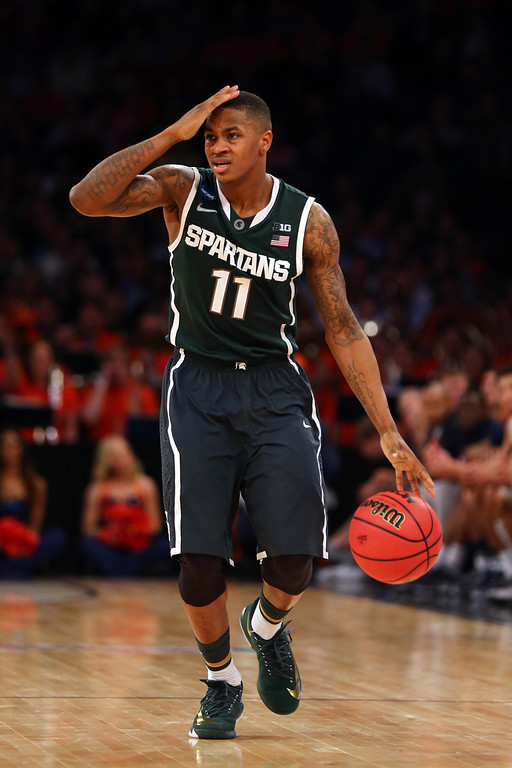 . Keith Appling #11 of the Michigan State Spartans gestures as he bring the ball up the court against the Virginia Cavaliers during the regional semifinal of the 2014 NCAA Men\'s Basketball Tournament at Madison Square Garden on March 28, 2014 in New York City.  (Photo by Elsa/Getty Images)