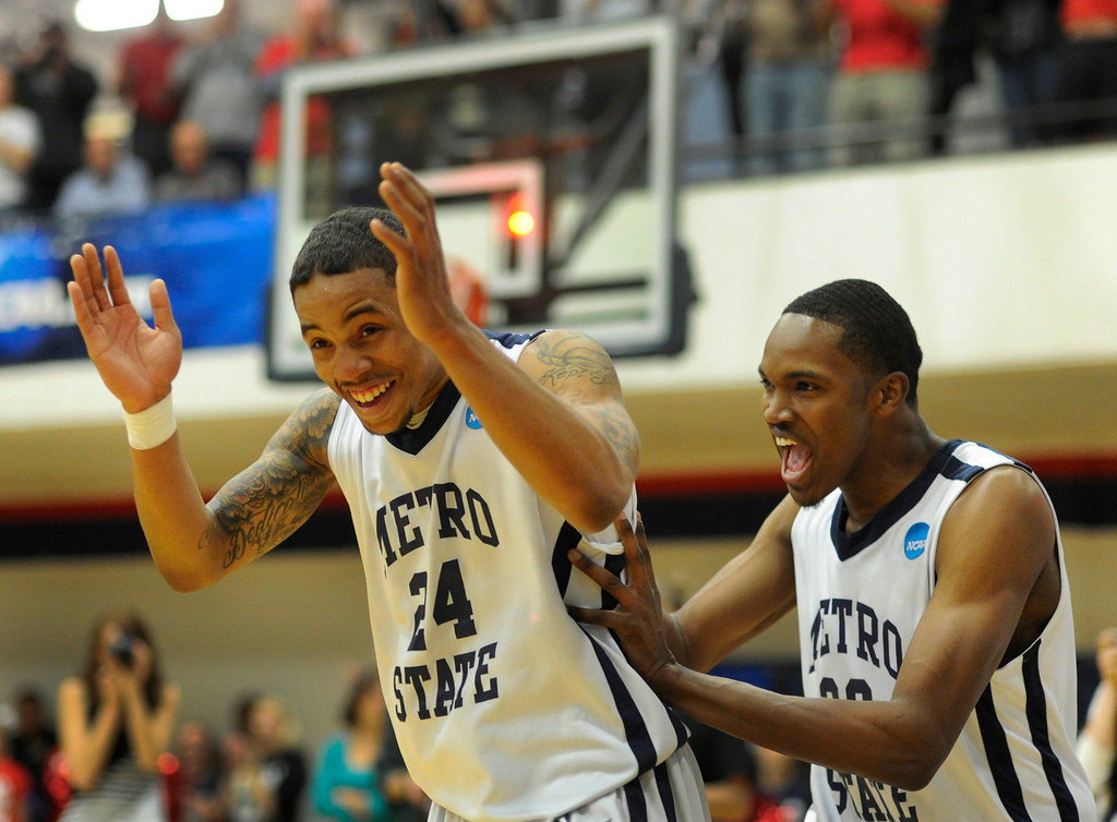 . DENVER, CO. - MARCH 19: Demetrius Miller, (24) and DeShawn Phenix (20) celebrated at the end of the game. The Metro State men\'s basketball team defeated St. Mary\'s (Texas) 78-70 in a RMAC playoff game Tuesday night, March 19, 2013. With the win the Roadrunners secured the South Central regional championship (Photo By Karl Gehring/The Denver Post)