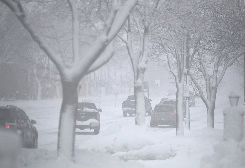 . Motorists drive on East Washington Avenue towards downtown Madison, Wis., during a strong snowstorm Thursday afternoon, Dec. 20, 2012. (AP Photo/Wisconsin State Journal, M.P. King)