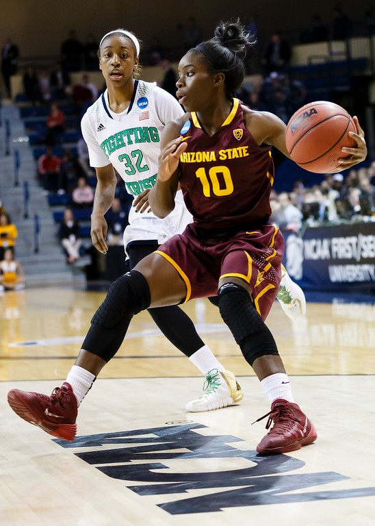 . Arizona State guard Promise Amukamara (10) dribbles around Notre Dame guard Jewell Loyd (32) during the first half in a second-round game in the NCAA women\'s college basketball tournament in Toledo, Ohio, Monday, March 24, 2014. (AP Photo/Rick Osentoski)