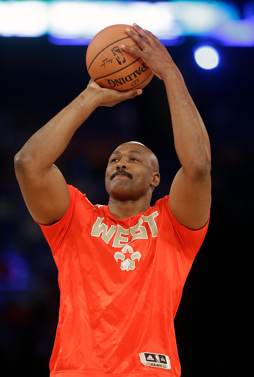 . Former NBA player Karl Malone shoots during the skills competition at the NBA All Star basketball game, Saturday, Feb. 15, 2014, in New Orleans. (AP Photo/Gerald Herbert)