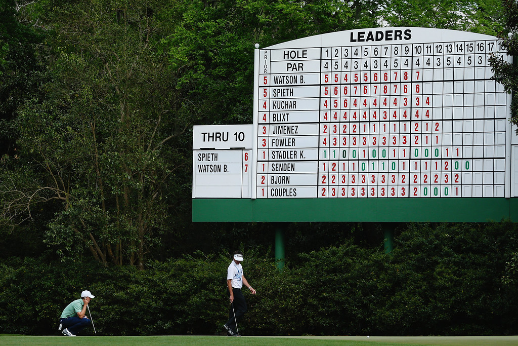 . Jordan Spieth of the United States lines up his putt on the 11th hole as Bubba Watson of the United States looks on during the final round of the 2014 Masters Tournament at Augusta National Golf Club on April 13, 2014 in Augusta, Georgia.  (Photo by Andrew Redington/Getty Images)