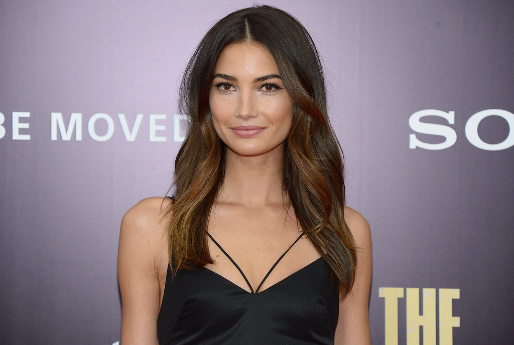 """. Model Lily Aldridge attends the \""""Monument Men\"""" premiere at Ziegfeld Theater on February 4, 2014 in New York City, New York.  (Photo by Michael Loccisano/Getty Images)"""
