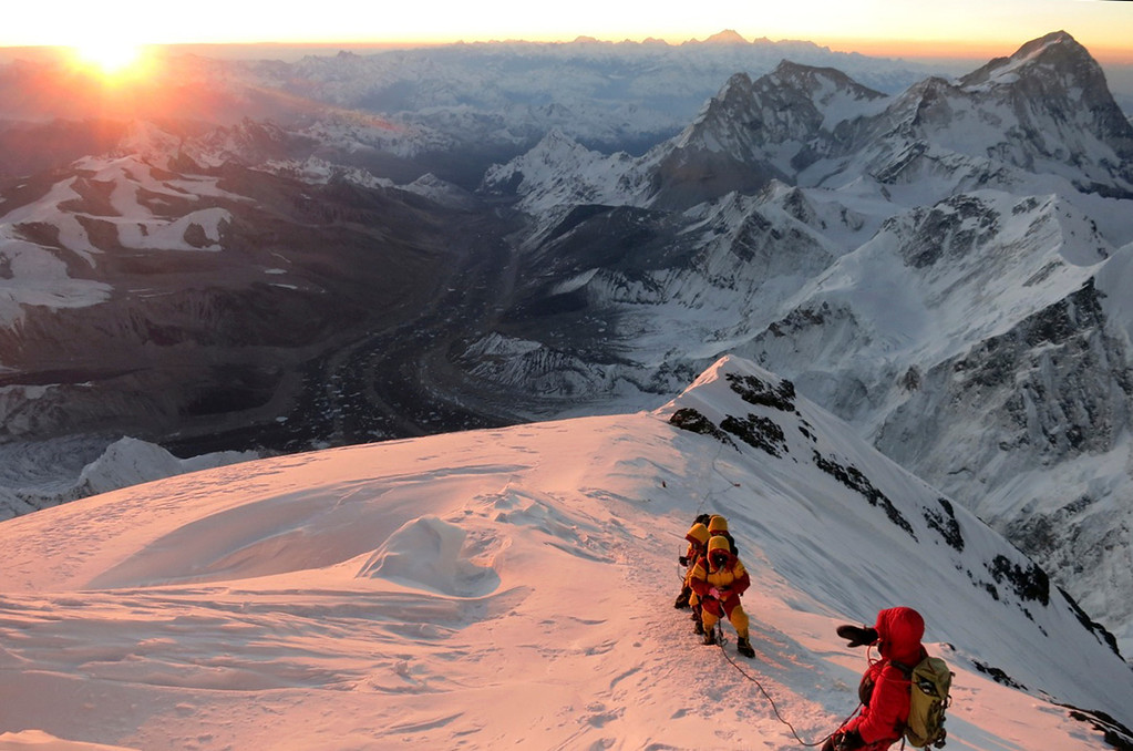 . FILE - In this May 18, 2013 file photo released by mountain guide Adrian Ballinger of Alpenglow Expeditions, climbers make their way to the summit of Mount Everest, in the Khumbu region of the Nepal Himalayas. An avalanche swept down a climbing route on Mount Everest early Friday, April 18, killing at least 12 Nepalese guides and leaving three missing in the deadliest disaster on the world\'s highest peak. (AP Photo/Alpenglow Expeditions, Adrian Ballinger, File)