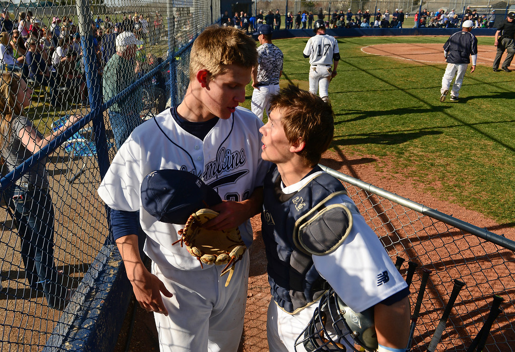 . LITTLETON, CO - APRIL 16,  2014: Columbine catcher Tommy Gillman, right, congratulates pitcher Blake Weiman, left, after the fourth inning in their game against  the Ralston Valley Mustangs at Columbine High School in Littleton, Co on April 17, 2014. Columbine pitcher Blake Weiman had a great game and was taken out in the fifth inning when the Rebels were up 8 to 1 over the Mustangs. (Photo By Helen H. Richardson/ The Denver Post)