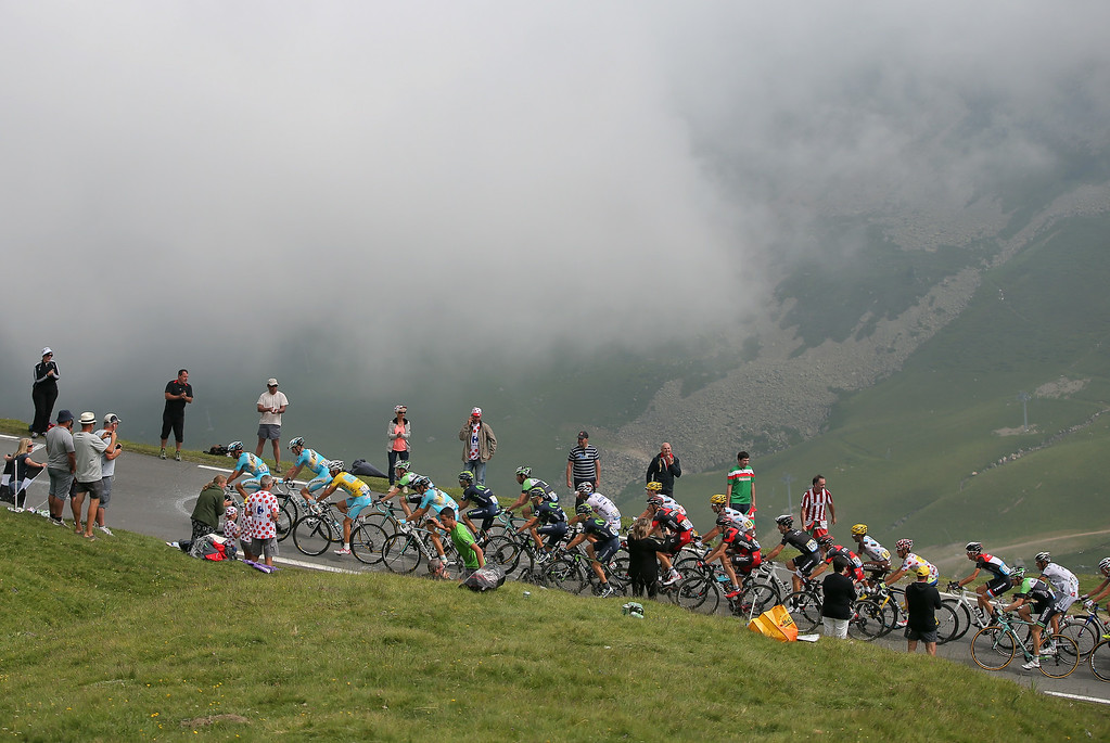 . Vincenzo Nibali of Italy and the Astana Pro Team defends the overall race leader\'s yellow jersey as he and his teammates lead the group into the clouds on the climb of the Col du Tourmalet during the eighteenth stage of the 2014 Tour de France, a 146km stage between Pau and Hautacam, on July 24, 2014 in La Mongie, France.  (Photo by Doug Pensinger/Getty Images)