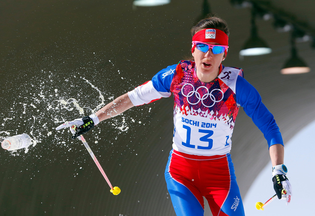 . Czech Republic\'s Eva Vrabcova-Nyvltova throws a bottle of water as she skis during the women\'s 30K cross-country race at the 2014 Winter Olympics, Saturday, Feb. 22, 2014, in Krasnaya Polyana, Russia. (AP Photo/Dmitry Lovetsky)