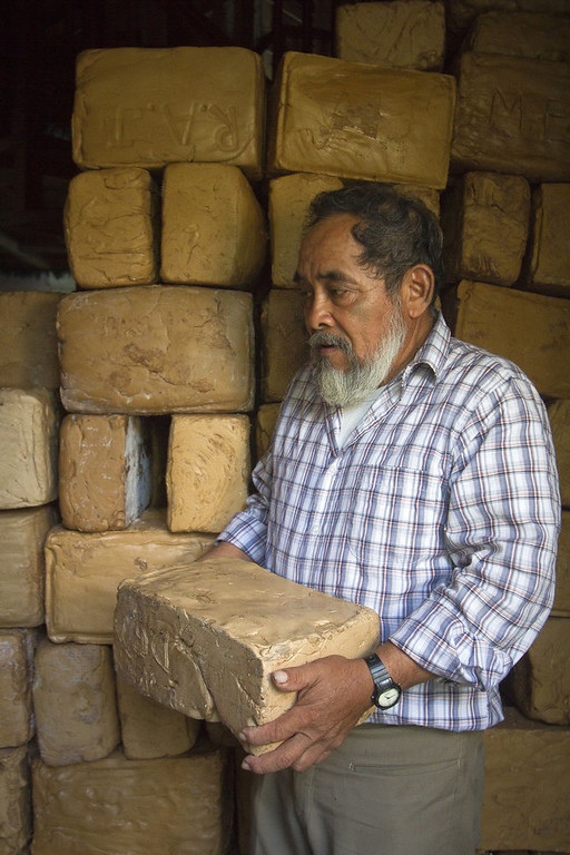 """. The president of the cooperative Tres Garantias, Raymundo Terron, loads a pack of base of gum in a cellar in Tres Garantias, Quintana Roo State, Mexico, on November 16, 2012. Small chewing gum producers are using old Mayan ways in the Yucatan rainforest to harvest the original \""""chicle\"""", which is making a comeback thanks to growing demand for organic gum in Europe and Asia. Pedro PARDO/AFP/Getty Images"""