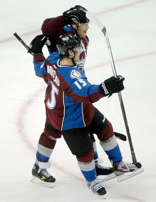 . Colorado center Paul Stastny (26) celebrated his goal with wing P.A Parenteau (15) in the third period. Paranteau had the assist on the goal.   Photo By Karl Gehring/The Denver Post