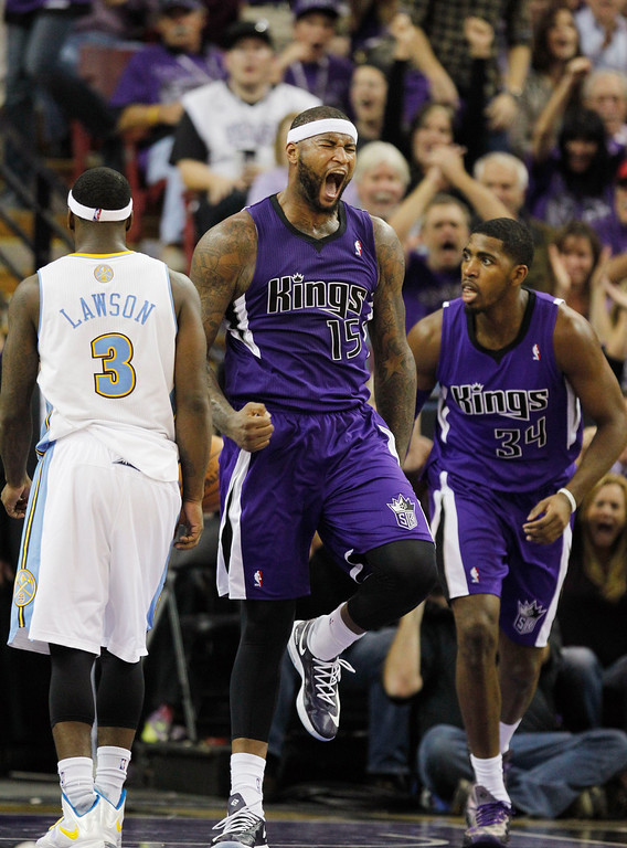 . Sacramento Kings center DeMarcus Cousins (15) celebrates after dunking against the Denver Nuggets during the fourth quarter of an NBA basketball game, Wednesday, Oct. 30, 2013, in Sacramento. The Kings won 90-88. (AP Photo/Genevieve Ross)