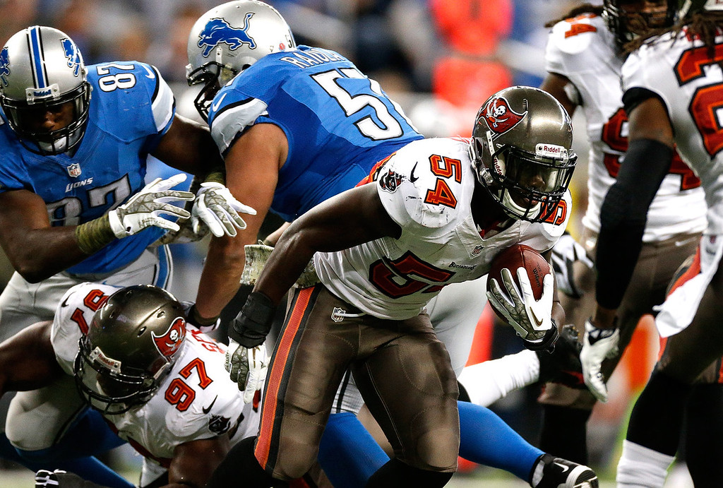 . Lavonte David #54 of the Tampa Bay Buccaneers intercepts a pass in the first quarter against the Detroit Lions at Ford Field on November 24, 2013 in Detroit, Michigan. (Photo by Gregory Shamus/Getty Images)