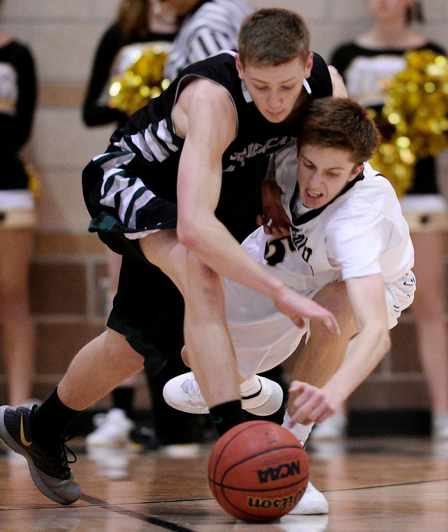 . Sawyer Novak of Fossil Ridge High School (13), left, steals the ball from Brandon Bodnar of Fossil Ridge High School (5) the 2nd half of the game at Monarch High School Gym. (Photo by Hyoung Chang/The Denver Post)