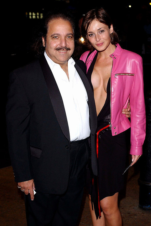 ". Actor Ron Jeremy with a lady friend arrive for the ""Gumball 3000 The Movie\"" World Premiere held on November 20, 2003 at the Odeon Leicester Square, in London. (Photo by Steve Finn/Getty Images)"