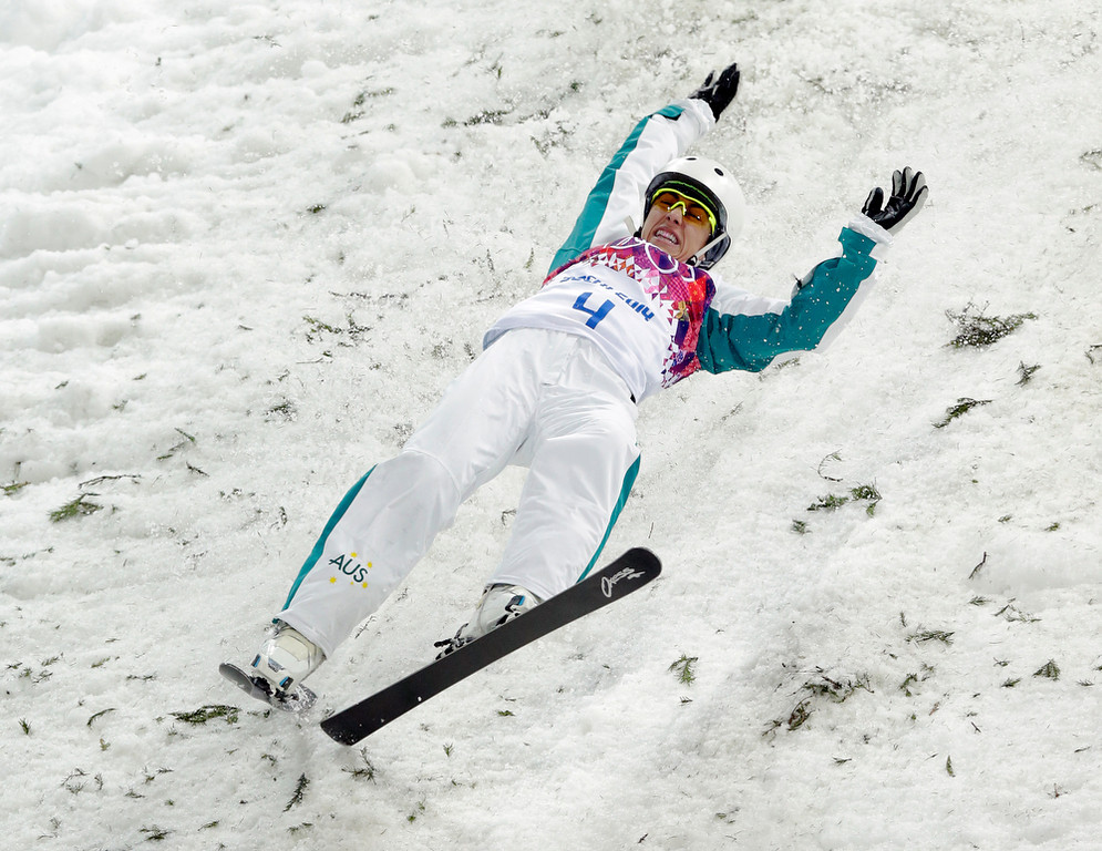 . Australia\'s Lydia Lassila crashes on her final jump in the women\'s freestyle skiing aerials final at the Rosa Khutor Extreme Park, at the 2014 Winter Olympics, Friday, Feb. 14, 2014, in Krasnaya Polyana, Russia. (AP Photo/Andy Wong)