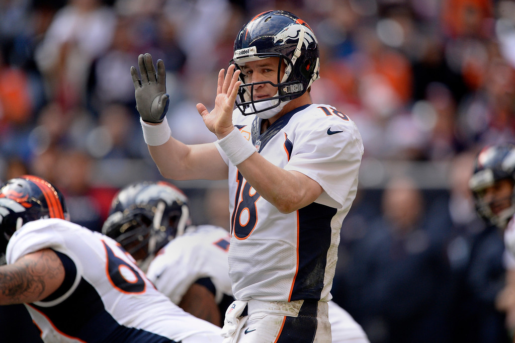 . Denver Broncos quarterback Peyton Manning (18) changing up on on the line of scrimmage against the Houston Texans during the third quarter December 22, 2013 at Reliant Stadium. (Photo by John Leyba/The Denver Post)