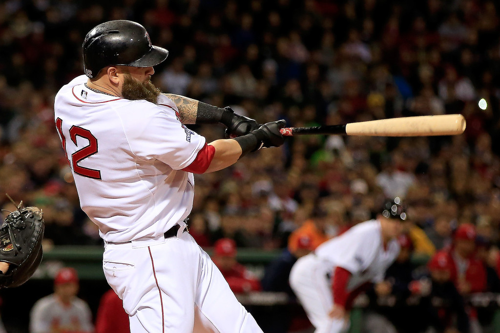 . Mike Napoli #12 of the Boston Red Sox hits a three run double in the first inning against the St. Louis Cardinals during Game One of the 2013 World Series at Fenway Park on October 23, 2013 in Boston, Massachusetts.  (Photo by Jamie Squire/Getty Images)