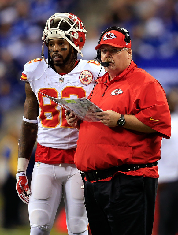 . INDIANAPOLIS, IN - JANUARY 04: Wide receiver Dwayne Bowe #82 and head coach Andy Reid of the Kansas City Chiefs look on during a Wild Card Playoff game against the Indianapolis Colts at Lucas Oil Stadium on January 4, 2014 in Indianapolis, Indiana.  (Photo by Rob Carr/Getty Images)