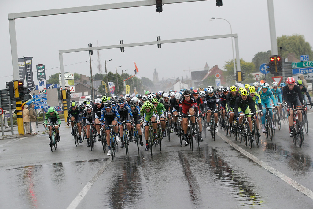 . The pack rides in pouring rain during the fifth stage of the Tour de France cycling race over 155 kilometers (96.3 miles) with start in Ypres, Belgium, and finish in Arenberg, France, Wednesday, July 9, 2014. The stage initially contained nine sectors of cobblestone roads dreaded by the majority of the riders in the pack especially under wet conditions, the organization decided to cancel two of the nine stretches because of the weather. (AP Photo/Christophe Ena)