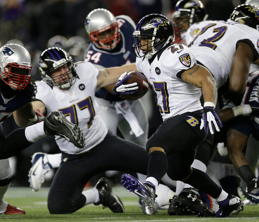 . Baltimore Ravens running back Ray Rice (27) runs with the ball during the first half of the NFL football AFC Championship football game against the New England Patriots in Foxborough, Mass., Sunday, Jan. 20, 2013. (AP Photo/Elise Amendola)