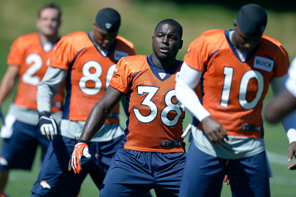 . Denver Broncos running back Montee Ball (38) stretches before practice  August 26, 2013 at Dove Valley. (Photo by John Leyba/The Denver Post)
