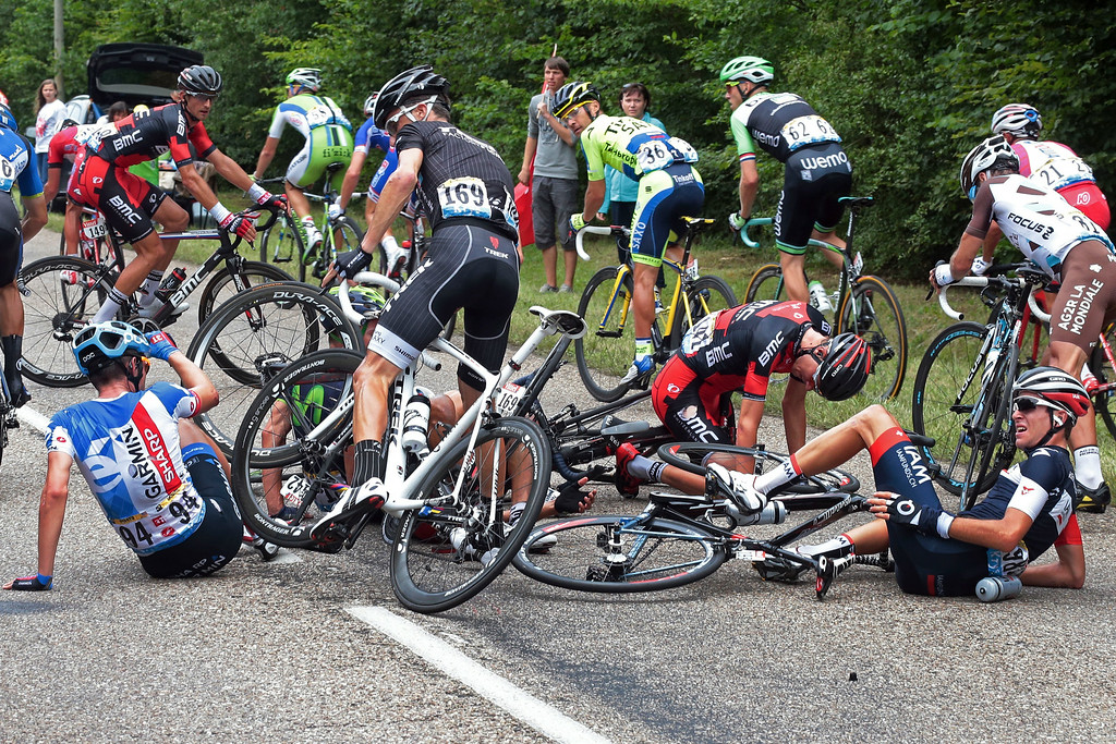 . Tejay van Garderen of the U.S., center right, Alex Howes of the U.S., left, and Switzerland\'s Sebastien Reichenbach, right, crash during the seventh stage of the Tour de France cycling race over 234.5 kilometers (145.7 miles) with start in Epernay and finish in Nancy, France, Friday, July 11, 2014. (AP Photo/Fred Mons, Pool)