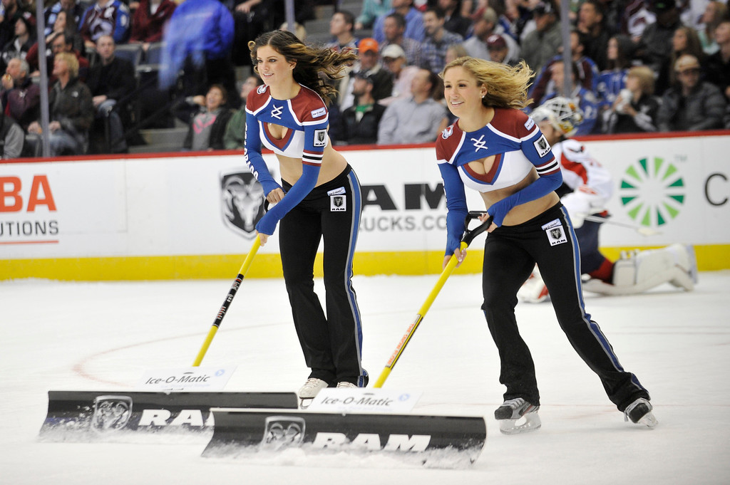 . The Avalanche Ice Girls clear the ice during a timeout during the Colorado Avalanche hockey game against the Washington Capitals at the Pepsi Center in Denver, Colorado on Sunday, November 10, 2013. (Photo By Patrick Traylor/The Denver Post)
