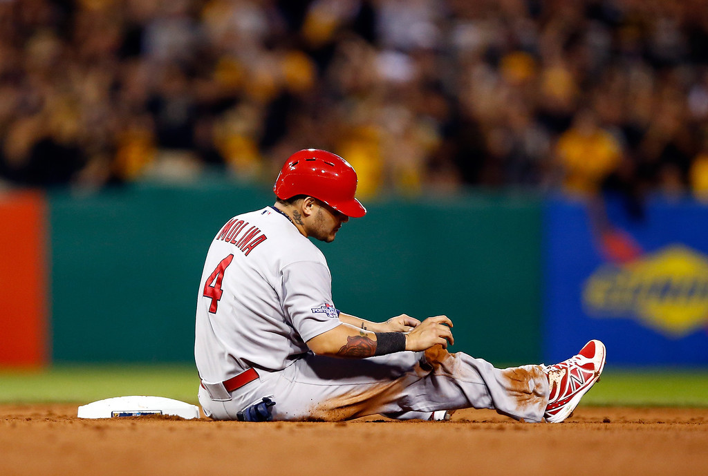 . Yadier Molina #4 of the St. Louis Cardinals reacts after being thrown out at second base in the eighth inning against the Pittsburgh Pirates during Game Three of the National League Division Series at PNC Park on October 6, 2013 in Pittsburgh, Pennsylvania.  (Photo by Justin K. Aller/Getty Images)