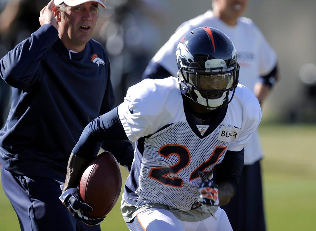 . Denver Broncos cornerback Champ Bailey (24) runs through drills during practice November 13, 2013 at Dove Valley (Photo by John Leyba/The Denver Post)