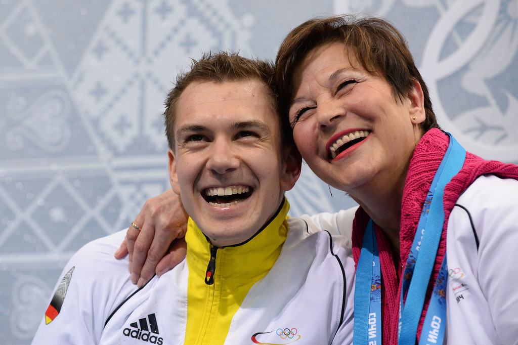 . Germany\'s Peter Liebers and his coach Viola Striegler pose in the kiss and cry zone the Men\'s Figure Skating Short Program at the Iceberg Skating Palace during the Sochi Winter Olympics on February 13, 2014.   YURI KADOBNOV/AFP/Getty Images