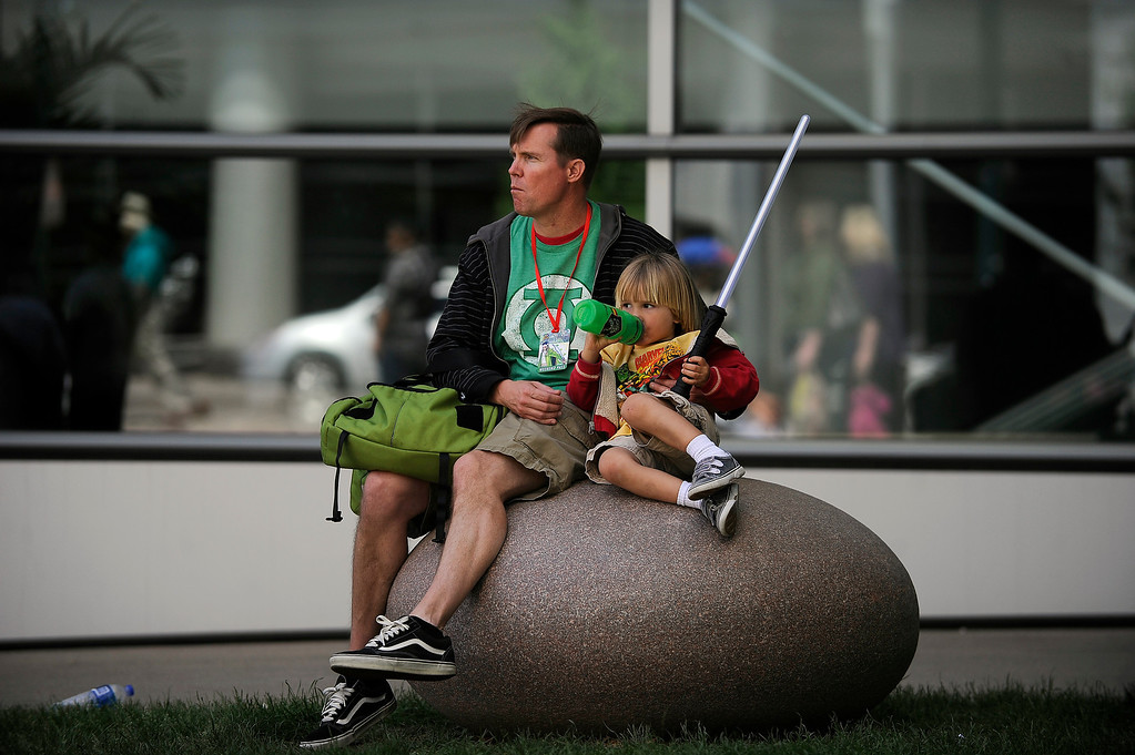 . DENVER, CO - JUNE 1: Kian Maloney, 3, snuggles up to his dad, Scott, as the two take a break outside of the Colorado Convention Center during Denver Comic Con on June 1, 2013 in Denver, Colorado. (Photo by Seth McConnell/The Denver Post)