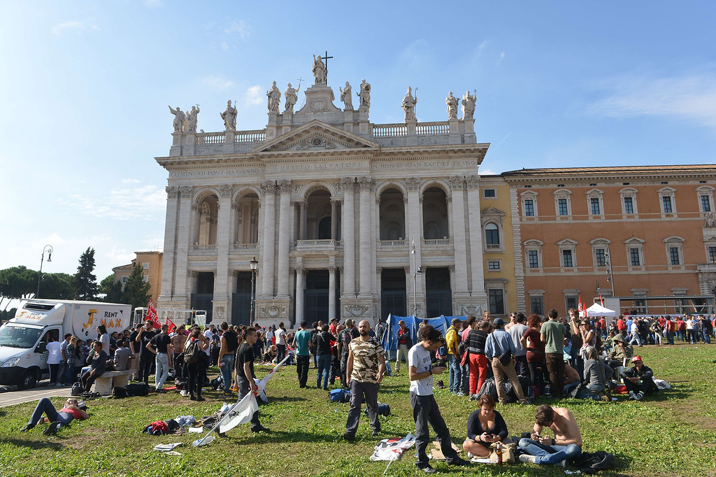 . People gather in front of the St Giovanni church in Rome before the start of an anti-austerity protest led by anti high-speed rail movement (No Tav) and an association for rights to housing, on October 19, 2013. ALBERTO PIZZOLI/AFP/Getty Images