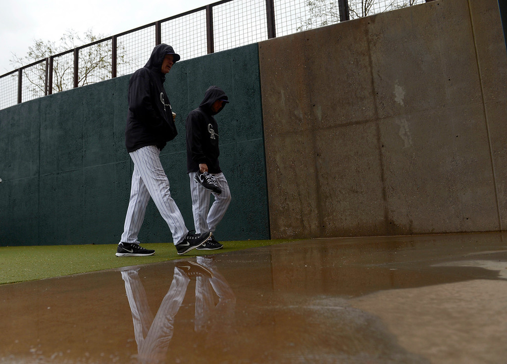 . SCOTTSDALE, AZ. - FEBRUARY 20: With the fields covered up, Colorado Rockies players head to the cages due to rain during Spring Training  February 20, 2013 in Scottsdale. (Photo By John Leyba/The Denver Post)