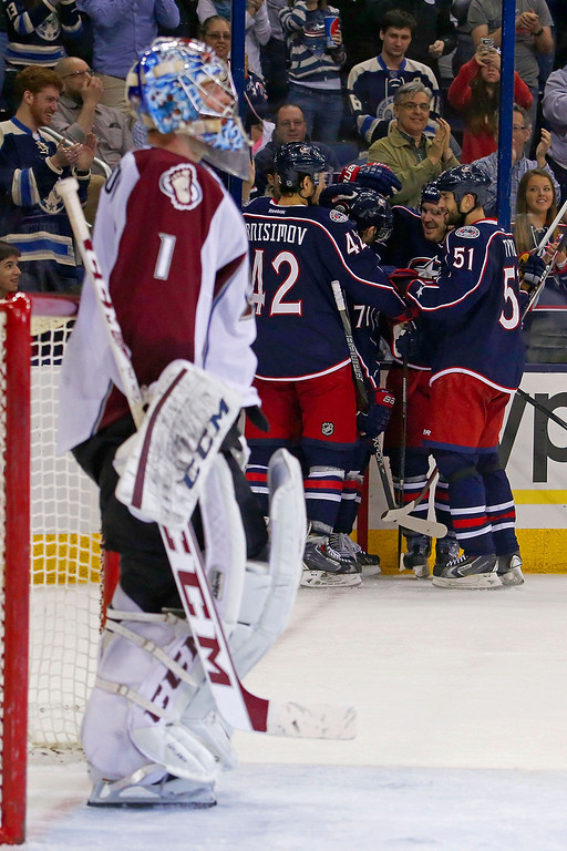 . COLUMBUS, OH - APRIL 1:  Blake Comeau #14 of the Columbus Blue Jackets is congratulated by his teammates after beating Semyon Varlamov #1 of the Colorado Avalanche for a goal during the second period on April 1, 2014 at Nationwide Arena in Columbus, Ohio. (Photo by Kirk Irwin/Getty Images)