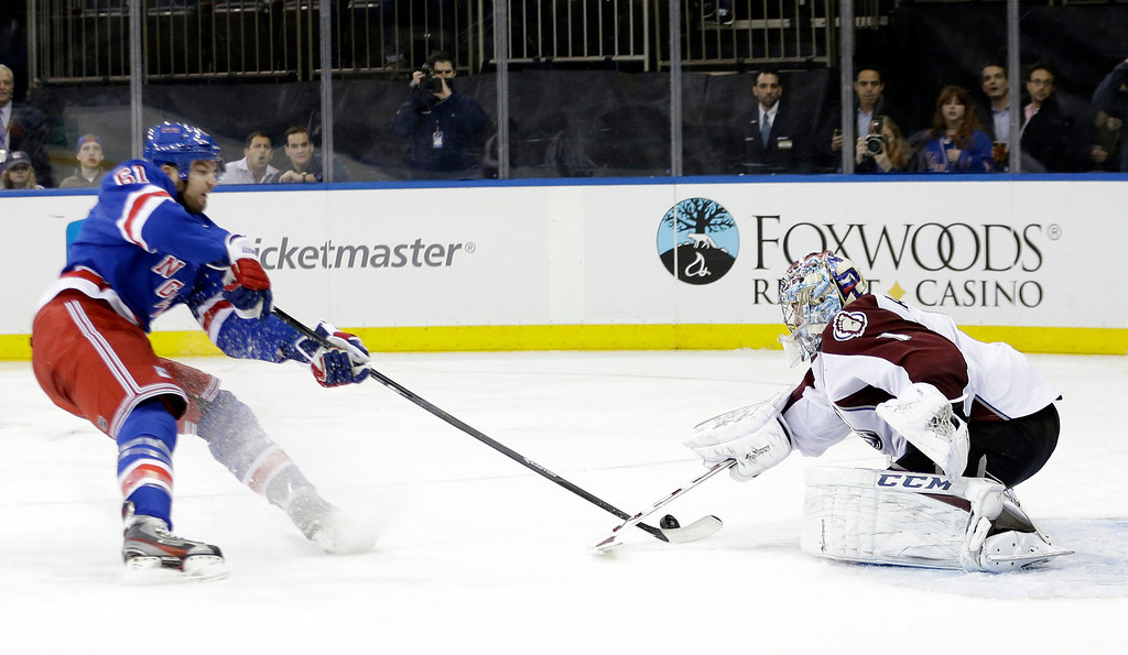 . Colorado Avalanche\'s Semyon Varlamov (1) stops a shot-on-goal by New York Rangers\' Rick Nash (61) during the second period of an NHL hockey game, Tuesday, Feb. 4, 2014, in New York. (AP Photo/Frank Franklin II)
