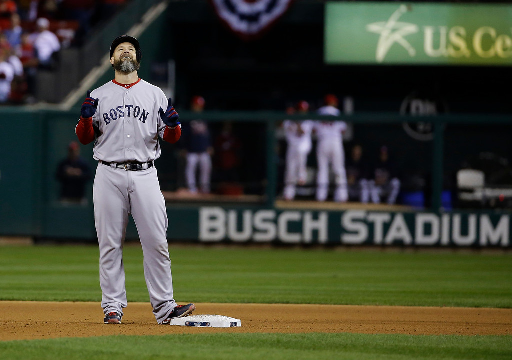. Boston Red Sox catcher David Ross reacts after hitting an RBI ground rule double to left field against the St. Louis Cardinals during the seventh inning of Game 5 of baseball\'s World Series Monday, Oct. 28, 2013, in St. Louis. (AP Photo/Matt Slocum)