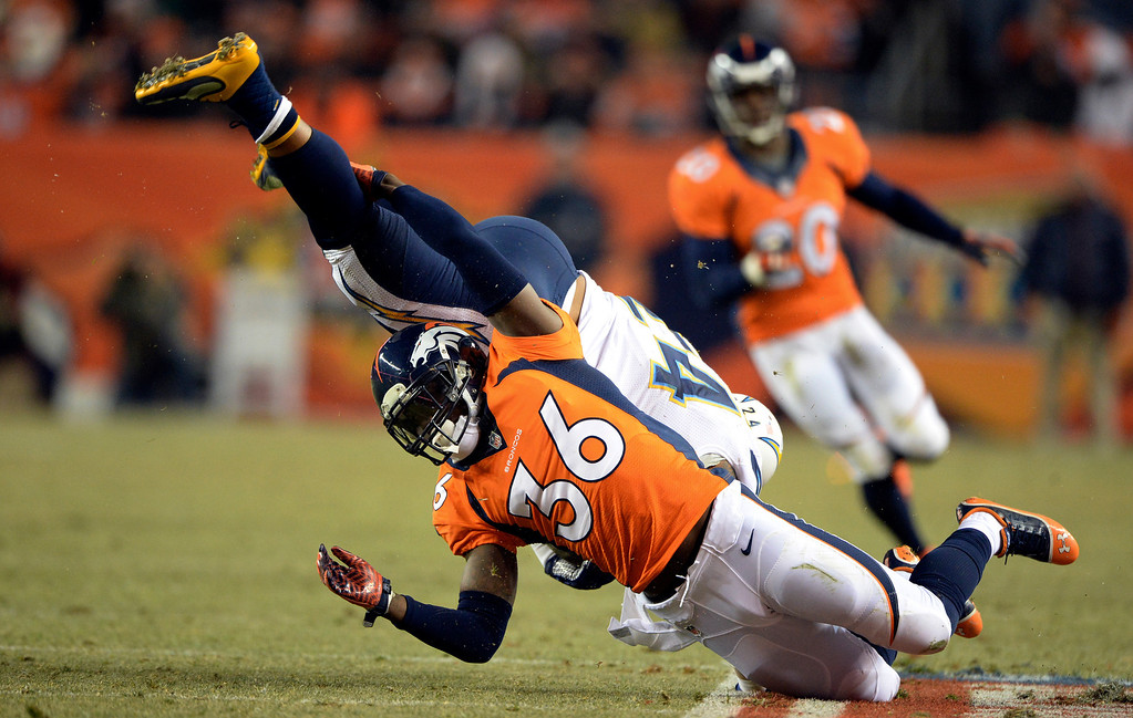 . DENVER, CO - DECEMBER 12: Denver Broncos cornerback Kayvon Webster (36) takes down San Diego Chargers running back Ryan Mathews (24) during the second half.  The Denver Broncos vs. the San Diego Chargers at Sports Authority Field at Mile High in Denver on December 12, 2013. (Photo by Hyoung Chang/The Denver Post)