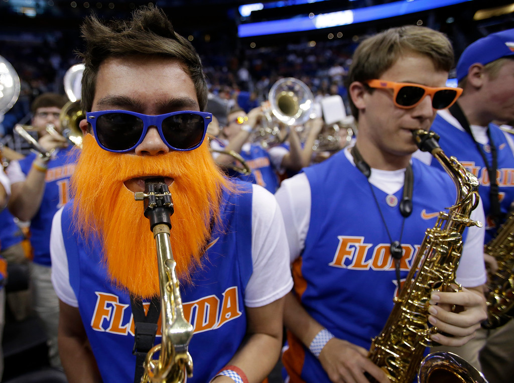 . Florida saxophone player Nathan Evens. left, performs during the first half in a second-round game against Albany in the NCAA college basketball tournament on Thursday, March 20, 2014, in Orlando, Fla. (AP Photo/John Raoux)