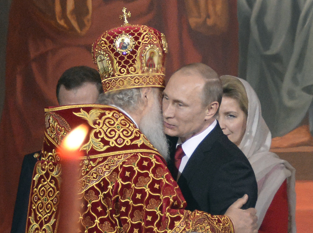 . Russian Orthodox Patriarch Kirill (L) congratulates Russian President Vladimir Putin during a service for the celebration of the Orthodox Easter in Moscow, early on April 20, 2014. AFP PHOTO/ ALEXANDER NEMENOV/AFP/Getty Images