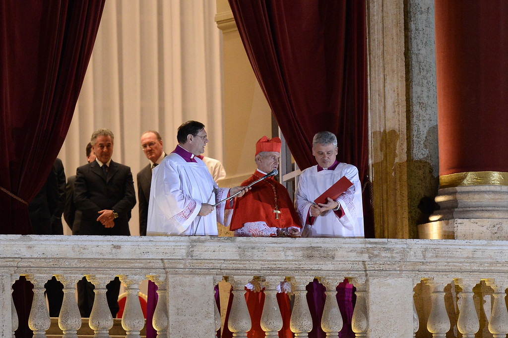 . French proto-deacon cardinal Jean-Louis Tauran (C) announces the name of the new Pope, Argentinian cardinal Jorge Mario Bergoglio on March 13, 2013 from the balcony of St Peter\'s basilica at the Vatican.  AFP FILIPPO MONTEFORTE/AFP/Getty Images