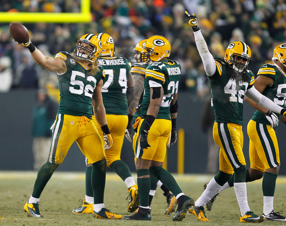 . Green Bay Packers outside linebacker Clay Matthews (52) celebrates after recovering a blocked punt during the second half of an NFL wild card playoff football game against the Minnesota Vikings Saturday, Jan. 5, 2013, in Green Bay, Wis. (AP Photo/Mike Roemer)