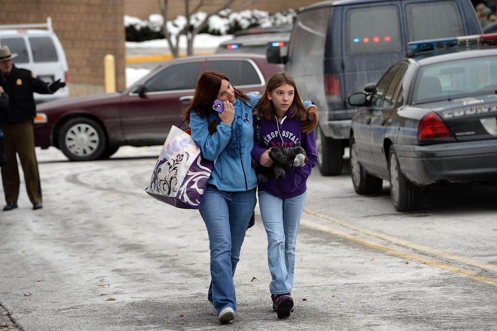 . Two shoppers leave the Columbia Mall after a fatal shooting on January 25, 2014, in Columbia, Maryland. AFP PHOTO/Jewel SAMAD/AFP/Getty Images