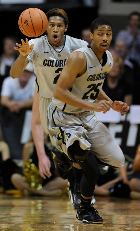 . Buffs forward Xavier Johnson (2) started a fast break with Spencer Dinwiddie (25) in the first half. The University of Colorado men\'s basketball team hosted Colorado State University inside the Coors Events Center Wednesday night, November 5, 2012. Karl Gehring/The Denver Post