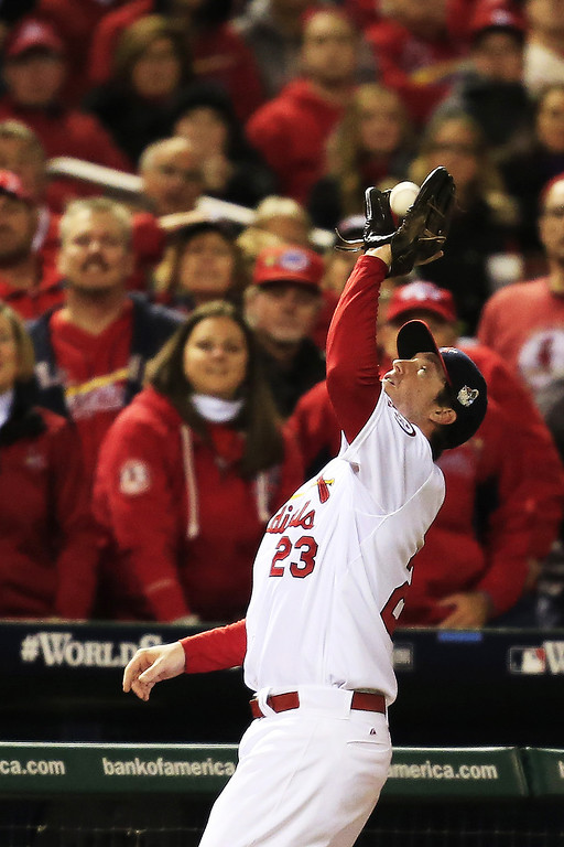 . David Freese #23 of the St. Louis Cardinals catches a foul ball hit by Stephen Drew #7 of the Boston Red Sox in the third inning during Game Four of the 2013 World Series at Busch Stadium on October 27, 2013 in St Louis, Missouri.  (Photo by Dilip Vishwanat/Getty Images)