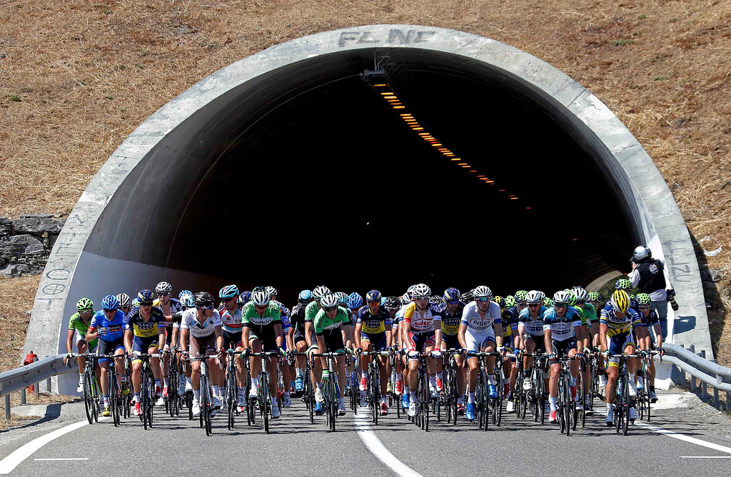 . The pack of riders exists a tunnel as it cycles on its way during the 156 km second stage of the centenary Tour de France cycling race from Bastia to Ajaccio, on the French Mediterranean island of Corsica June 30, 2013.     REUTERS/Jean-Paul Pelissier